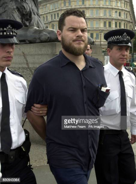Police officers detain Sulayman Keeler after he addressed a Muslim AlMuhajiroun rally in London's Trafalgar Square