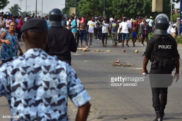 POlice officers disperse angry subscribers who invested in agribusiness companies during a demonstration on February 18 2017 in Abidjan after justice...