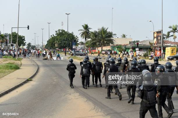 Police officers disperse protester angry subscribers who invested in agribusiness companies during a demonstration on February 18 2017 in Abidjan...