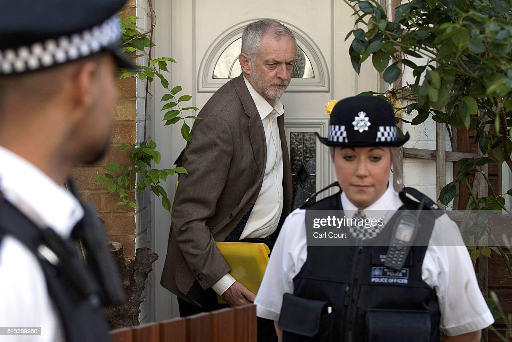 Police officers escort Labour leader <a gi-track='captionPersonalityLinkClicked' href=/galleries/search?phrase=Jeremy+Corbyn&family=editorial&specificpeople=2596361 ng-click='$event.stopPropagation()'>Jeremy Corbyn</a> from his home on June 28, 2016 in London, England. Mr Corbyn is facing increased calls to resign as leader and a vote of no confidence later today is expected to see up to 150 MPs vote against him.