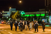 Police officers escort people from inside the shopping center as they respond to a shooting at the Olympia Einkaufzentrum at July 22 2016 in Munich...