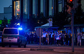 Police officers escort people with their hands raised from inside the shopping center as they respond to a shooting at the Olympia Einkaufzentrum at...