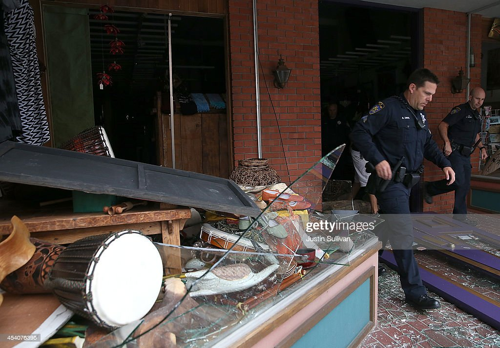 Police officers exit a damaged buillding following a reported 6.0 earthquake on August 24, 2014 in Napa, California. A 6.0 earthquake rocked the San Francisco Bay Area shortly after 3:00 am on Sunday morning causing damage to buildings and sending at least 70 people to a hospital with non-life threatening injuries.