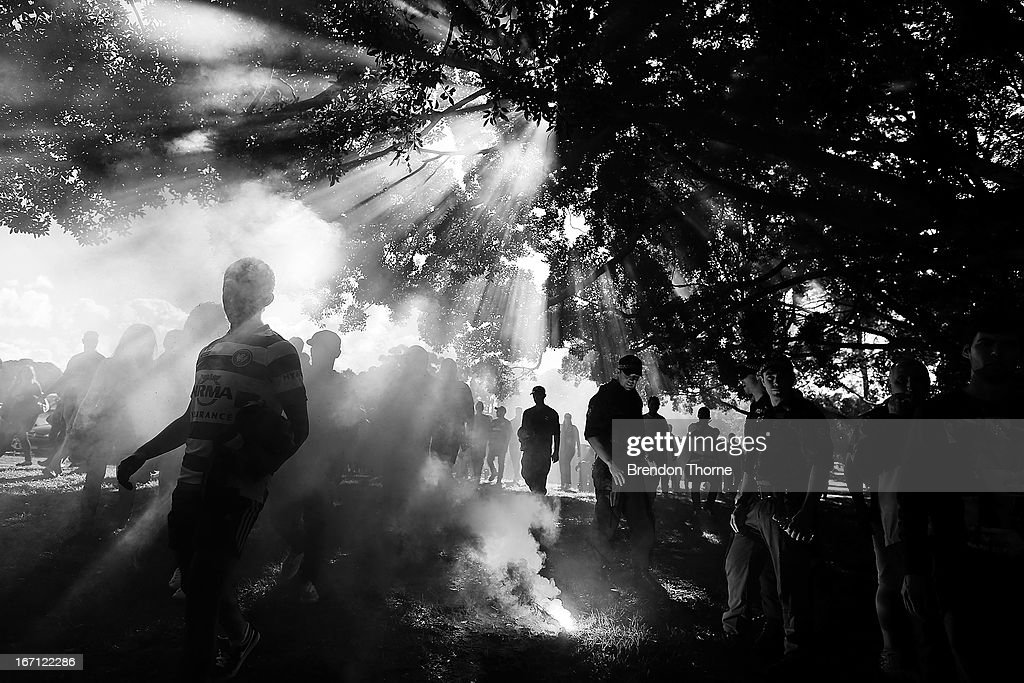 Police officers extinguish a flare as Western Sydney Wanderers fans walk to the stadium before the A-League 2013 Grand Final match between the Western Sydney Wanderers and the Central Coast Mariners at Allianz Stadium on April 21, 2013 in Sydney, Australia.