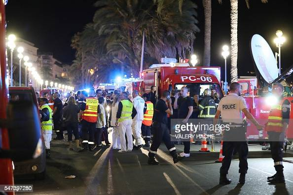 TOPSHOT Police officers firefighters and rescue workers are seen at the site of an attack on July 15 after a truck drove into a crowd watching a...