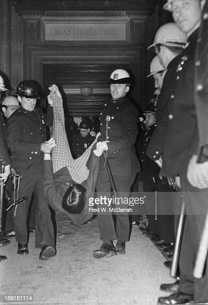 Police officers forcibly carry a student demonstrator out of the Mathematics Hall on the campus of Columbia University during campuswide protests New...