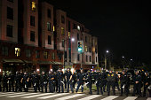 Police officers form a line along University Ave on the fourth night of demonstrations over recent grand jury decisions in policeinvolved deaths on...