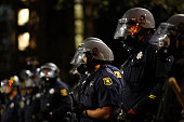 Police officers form a line on Telegraph Ave during the fourth night of demonstrations over recent grand jury decisions in policeinvolved deaths on...