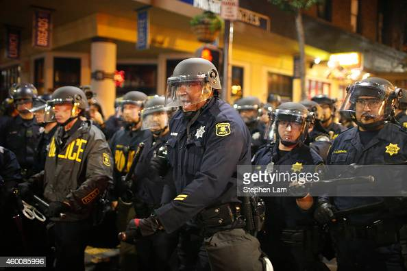 Police officers form a line on Telegraph Ave on the fourth night of demonstrations over recent grand jury decisions in policeinvolved deaths on...