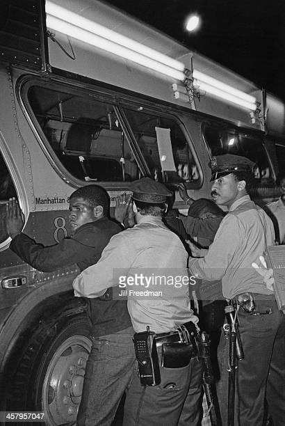 Police officers frisk suspects against a bus in Midtown Manhattan New York City 1980
