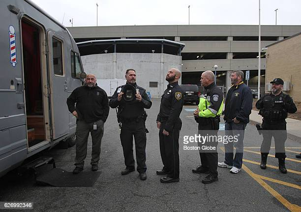 Police officers from 20 police departments across Massachusetts wait to have their beards shaved off outside of the MBTA Transit Headquarters in a...