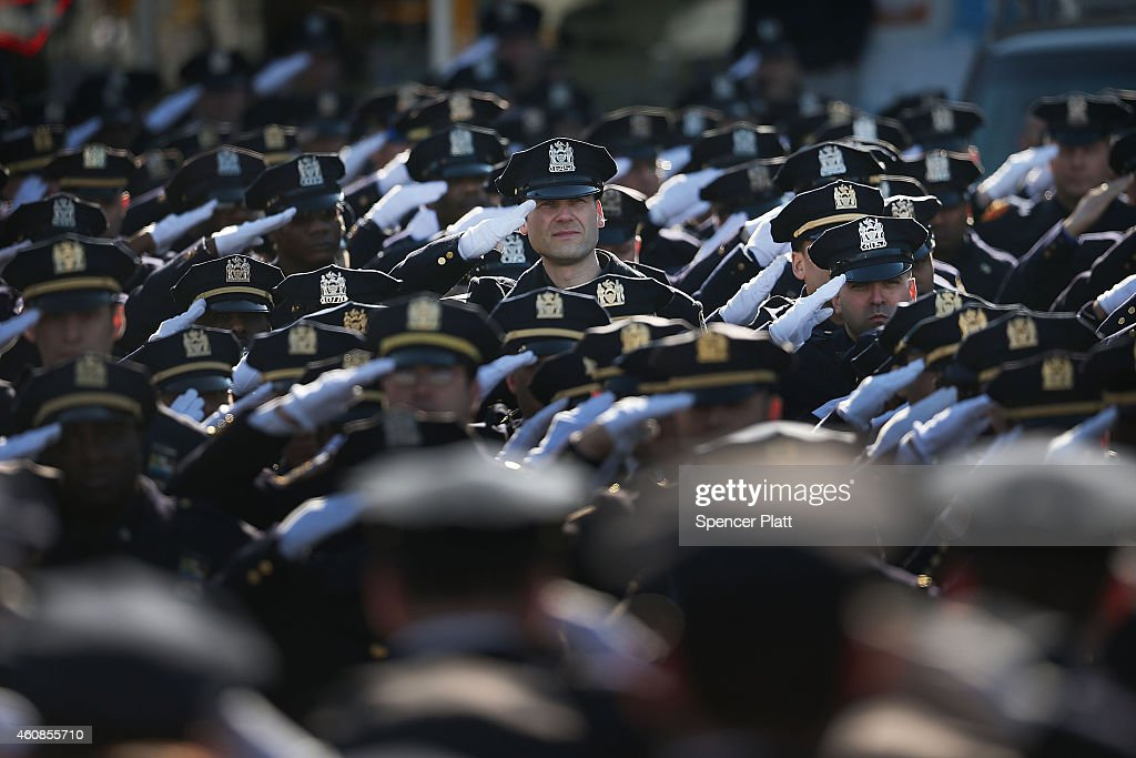 Police officers from around the country salute outside of Christ Tabernacle Church for the funeral of slain New York City Police Officer Rafael Ramos, one of two officers murdered while sitting in their patrol car in an ambush in Brooklyn last Saturday afternoon on December 27, 2014 in New York City. Thousands of fellow officers, family, friends and Vice President Joseph Biden are expected at the church in the Glendale neighborhood of Queens for the funeral.