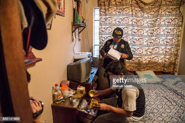 Police officers from the Green Squad examine the rooms of a suspected drug house on June 02 2017 in Lima Peru On August 18 2003 the Escuadron Verde...