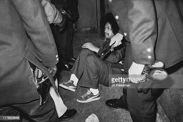 Police officers from the Midtown South Precinct arrest a man in Times Square New York City circa 1980