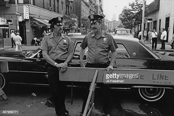 Police officers from the ninth precinct on duty at the Feast of St Anthony of Padua Procession Greenwich Village New York City 1980