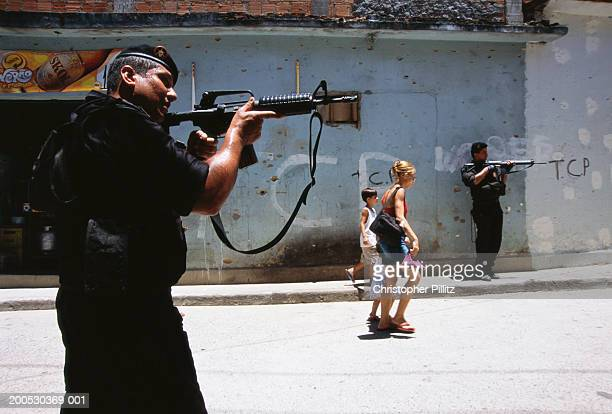 Police officers from the special task force BOPE on a drug search operation in a Rio de janeiro favela, Brazil.
