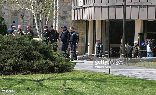 Police officers gather in front of McBryde Hall on the campus of Virginia Tech University after a shooting left at least 32 dead April 16 2007 in...