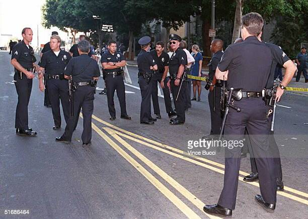 Police officers gather on the closed street outside the Criminal Courts building in Los Angeles after jurors in the OJ Simpson murder trial reached a...