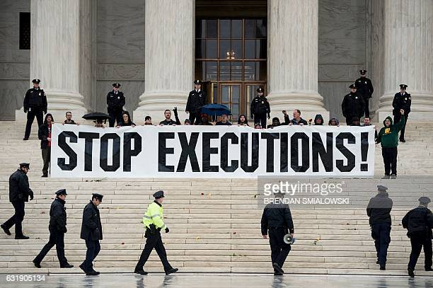 Police officers gather to remove activists during an anti death penalty protest in front of the US Supreme Court January 17 2017 in Washington DC /...