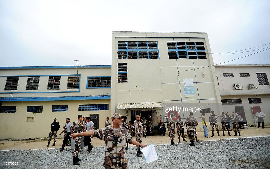 Police officers get ready for inmates without a sentence to cast their votes at the Social Rehabilitation Centre in Guayaquil, Ecuador, on February 15, 2013. There are over 8000 inmates without sentence in Ecuador who can vote in advance for Sunday's national election. Ecuadoran President Rafael Correa is favored to cruise to a new term Sunday to cement a 'socialist revolution' that has brought stability to a nation where several leaders were forced out before him. An outspoken voice of the Latin American left and friend of ailing Venezuelan President Hugo Chavez, the charismatic, US-educated economist is far ahead of his seven rivals in all opinion polls after six years in office.