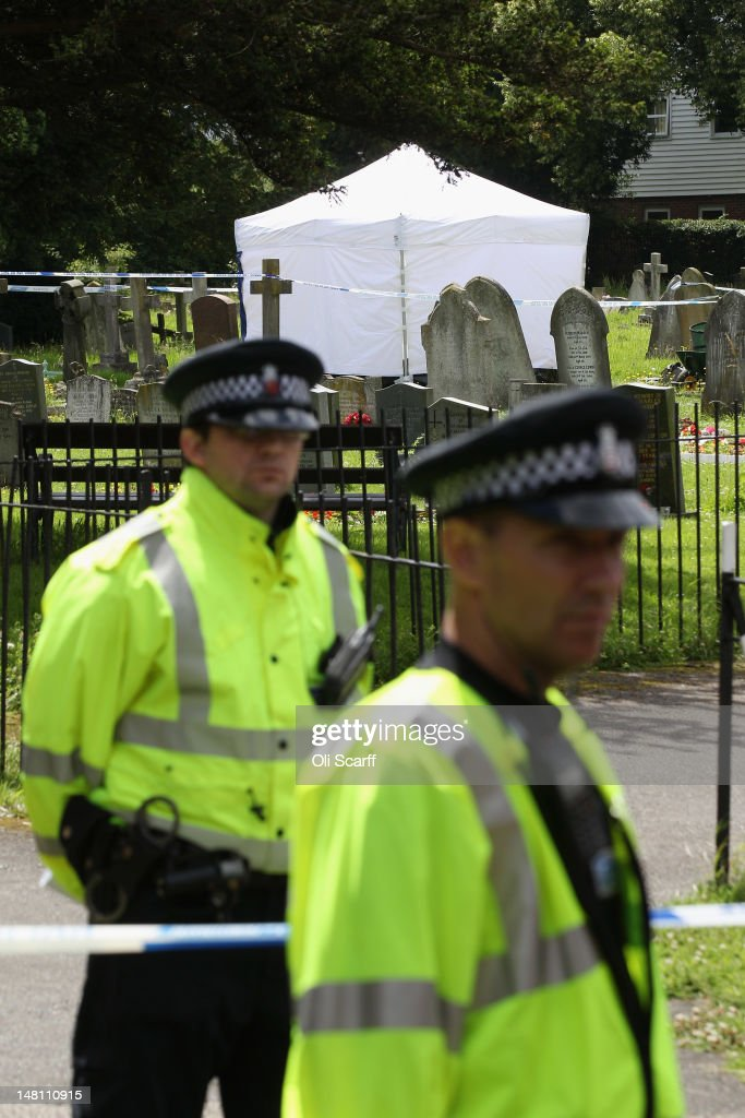 Police officers guard a churchyard in the village of Writtle, where the body of Peter Reeve has been found on July 10, 2012 near Chelmsford, England. Mr Reeve, 64, is suspected of shooting dead off-duty policeman PC Ian Dibell in Clacton-on-Sea on Monday July 9.