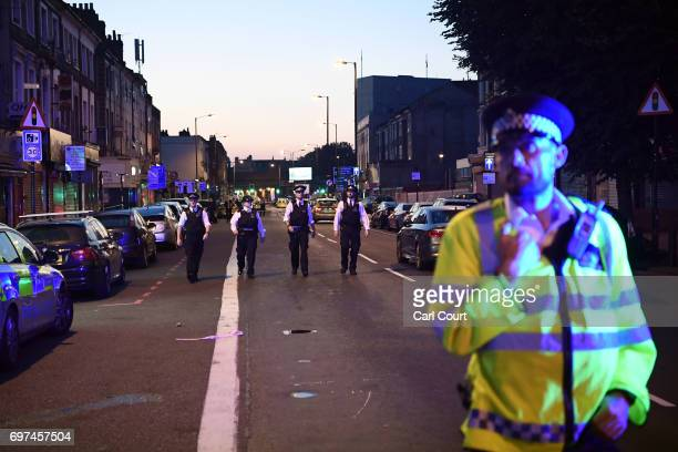 Police officers guard a road leading to Finsbury Park Mosque after an incident in which a van hit worshippers outside the building on June 19 2017 in...