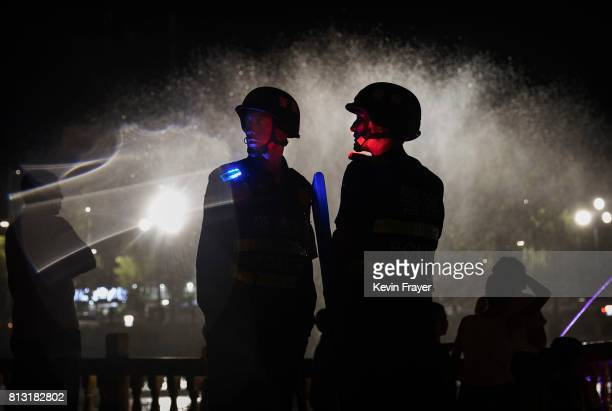 Police officers guard near a new laser and water show that is part of a local government tourism development on June 30 2017 in the old town of...