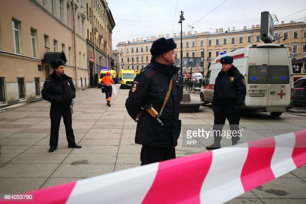 Police officers guard the area at the entrance to Technological Institute metro station in Saint Petersburg on April 3 2017 A blast hit the metro...