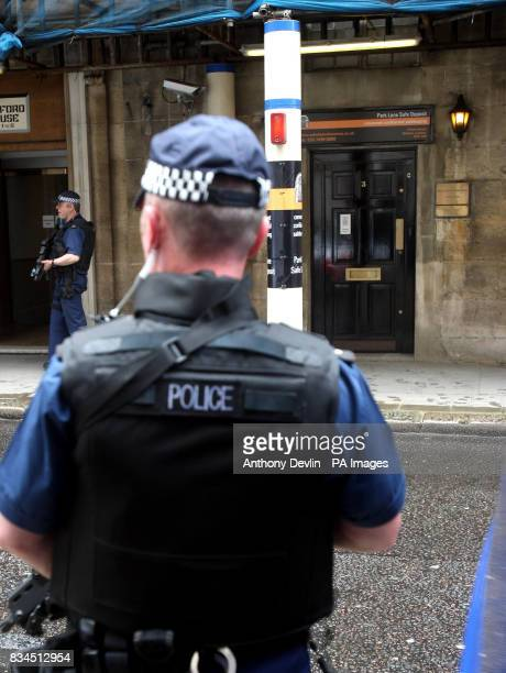 Police officers guard the entrance of Park Lane Safe Deposit Mayfair in connection with suspected money laundering operations London Police have...