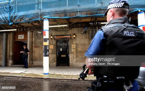 Police officers guard the entrance of Park Lane Safe Deposit Mayfair which was being raided in connection with suspected money laundering operations...