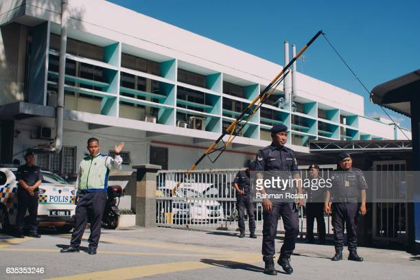 Police officers guard the entrance of the forensic department of Kuala Lumpur General Hospital where the body Jongnam is believed to be on February...