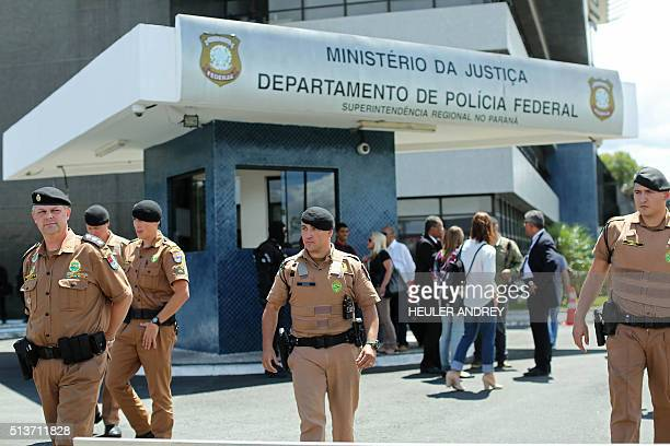Police officers guard the Federal Police headquarters in Curitiba Brazil while supporters of former Brazilian president Luiz Inacio Lula da Silva...