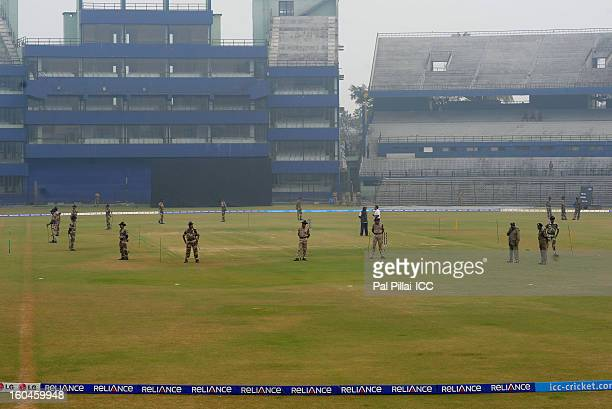 Police officers guard the pitch before the start of the second match of ICC Womens World Cup between Australia and Pakistan played at the Barabati...