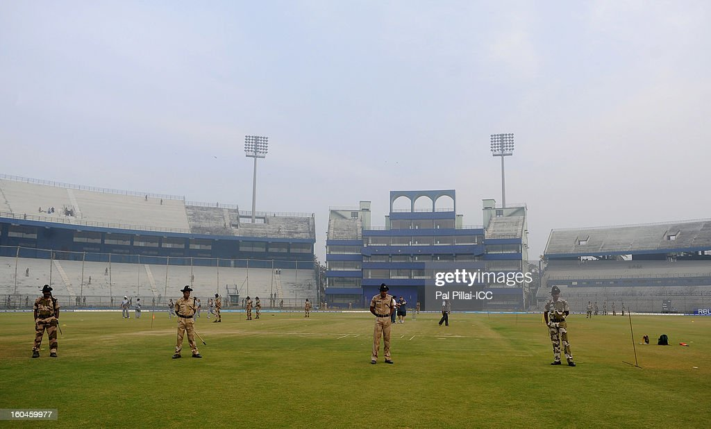 Police officers guard the pitch before the start of the second match of ICC Womens World Cup between Australia and Pakistan, played at the Barabati stadium on February 1, 2013 in Cuttack, India.