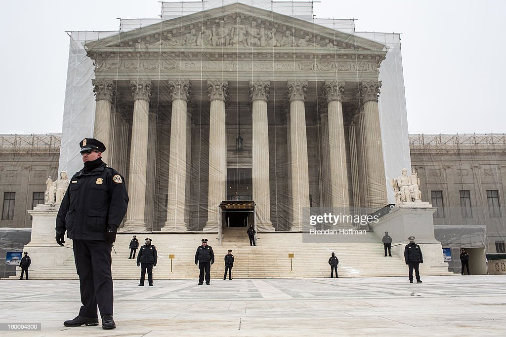 Police officers guard the plaza in front of the U.S. Supreme Court as anti-abortion protesters hold the March for Life on January 25, 2013 in Washington, DC. The pro-life gathering is held each year around the anniversary of the Roe v. Wade Supreme Court decision.