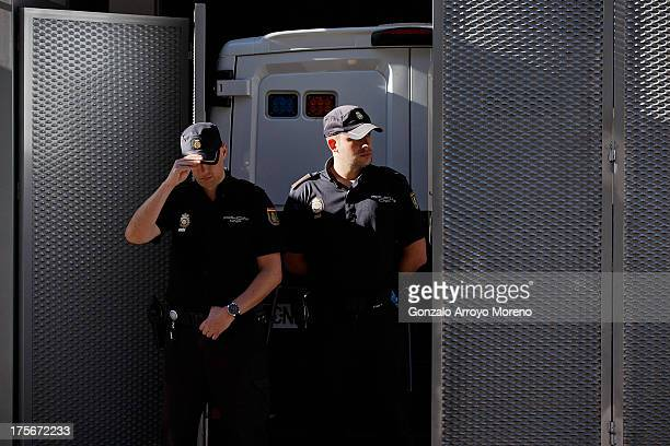 Police officers guard the prison van transporting convicted paedophile Daniel Galvan Vina at Audiencia Nacional court on August 6 2013 in Madrid...