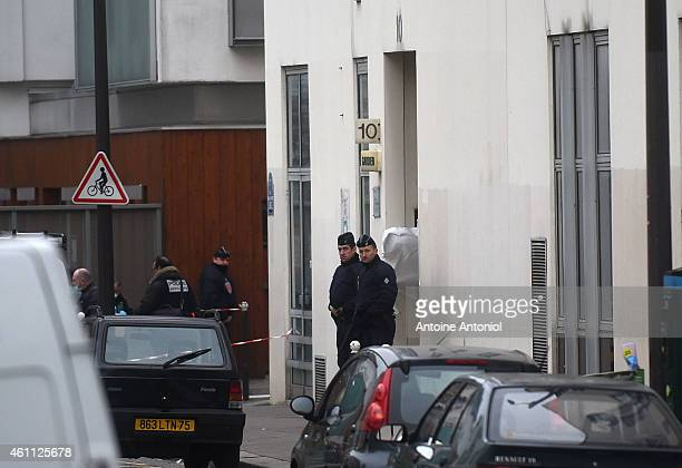 Police officers guards the offices of the French satirical newspaper Charlie Hebdo on January 7 2015 in Paris France Armed gunmen stormed the offices...