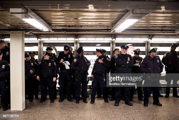 Police officers have their roll call in the Times Square subway stop following a series of terrorist attacks in Paris on November 14 2015 in New York...