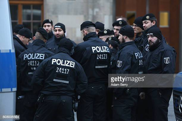 Police officers hold a meeting prior to a public New Year's Eve party at the Brandenburg Gate on December 31 2015 in Berlin Germany After the...