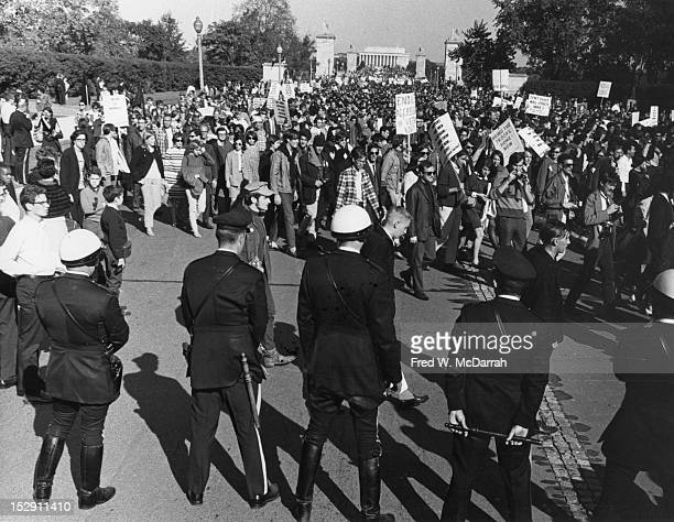 Police officers hold nightsticks as they watch demonstrators during the 'March on the Pentagon' Washington DC October 21 1967