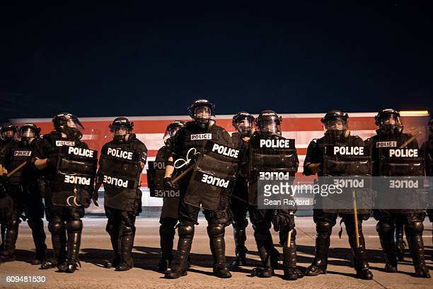 Police officers hold their line during protests on the I85 in the early hours of September 21 2016 in Charlotte North Carolina The protests began...