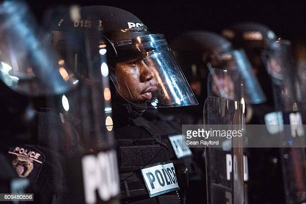 Police officers hold their line on the I85 during protests in the early hours of September 21 2016 in Charlotte North Carolina The protests began...