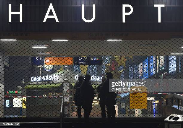 Police officers in riot gear are seen guarding the entrance to the closed central station in Munich on January 1 2016 German police said Thursday...