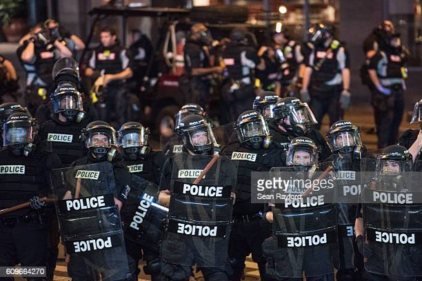 Police officers in riot gear hold their line September 21 2016 in downtown Charlotte NC Protests in Charlotte began on Tuesday in response to the...