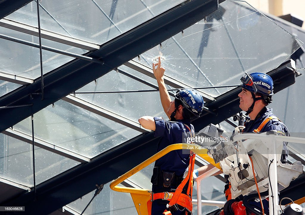 Police officers inspect a bullet hole at the Broadway Shopping Centre along Bay Street, Broadway on March 4, 2013 in Sydney, Australia. Shots were reportedly fired at an Armaguard truck and police are investigating what a spokesperson said appears to be an attempted robbery.