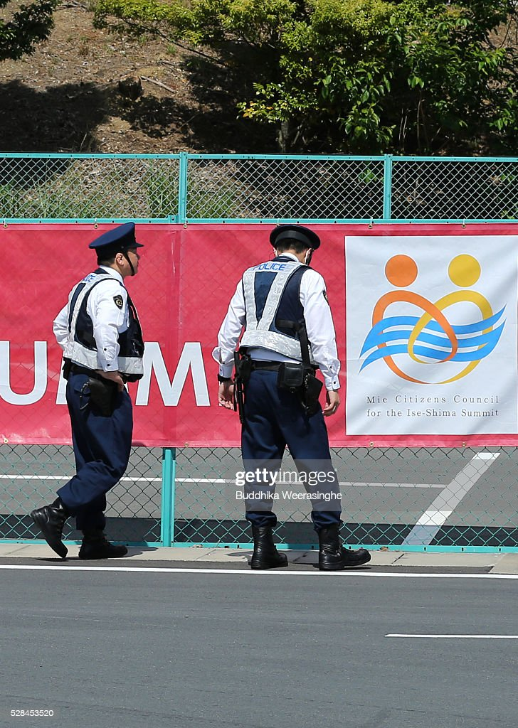 Police officers inspect fencing at a G7 Ise-shima summit welcome banner on May 5, 2016 in Ise, Japan. The G7 summit will be held in Ise-Shima, Mie prefecture on May 26 and 27, 2016.