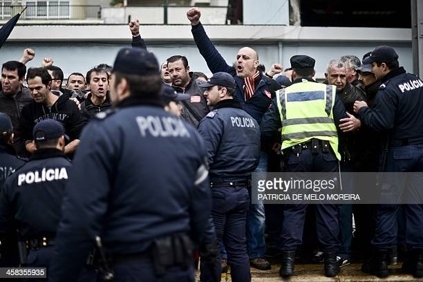Police officers intervene as railways workers try to stop trains on the railways in sign of protest against the government policies at Santa Apolonia...