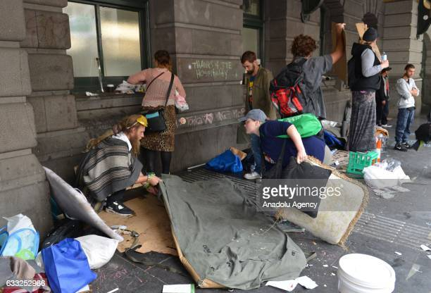 Police officers intervene protestors and homeless people after Victoria police evicted many from a makeshift camp outside Flinders St station in...