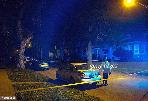 Police officers investigate a shooting scene where 5 people were reported to have been shot including an 11monthold infant on September 28 2015 in...