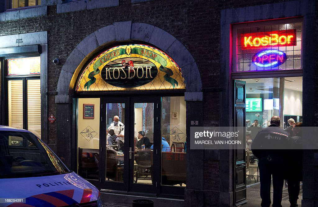 Police officers investigate inside a coffeeshop in Maastricht, southern Netherlands, on May 7, 2013. The coffeeshop allegedly sold drugs to foreigners, which is forbidden in the province of Limburg, which Maastricht belongs to. AFP PHOTO / ANP / MARCEL VAN HOORN